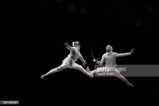 Luca Curatoli of Team Italy competes against Sanguk Oh of Team South Korea during the Men's Sabre Team Gold Medal Match on day five of the Tokyo 2020...