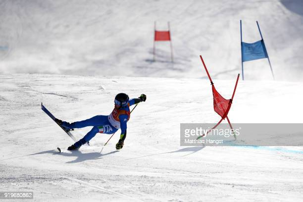 Luca De Aliprandini of Italy crashes during the Alpine Skiing Men's Giant Slalom on day nine of the PyeongChang 2018 Winter Olympic Games at...