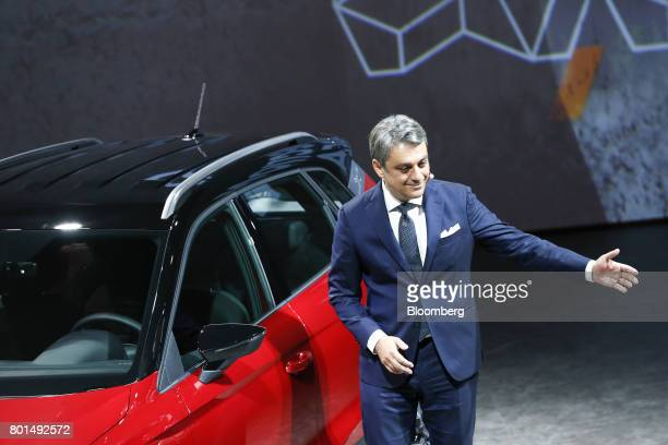 Luca de Meo chairman of Espanola de Automovil Turismo gestures after unveiling the company's new Arona compact sports utility vehicle during a launch...