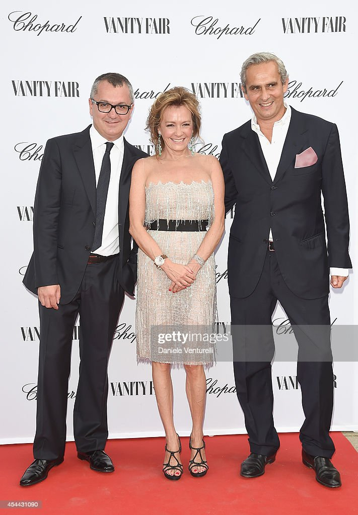 Luca Dini and Caroline Scheufele attend the Chopard And Vanity Fair Present 'Backstage At Cinecitta' Exhibition - Red Carpet - 71st Venice Film Festival at Cipriani Hotel on August 31, 2014 in Venice, Italy.
