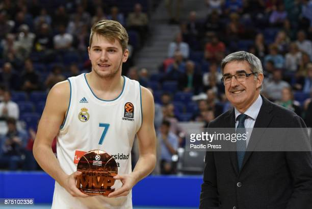 Luca Doncic #4 of Real Madrid poses for media with Eurolegue October MVP trophy during the Euroleague basketball match between Real Madrid and...