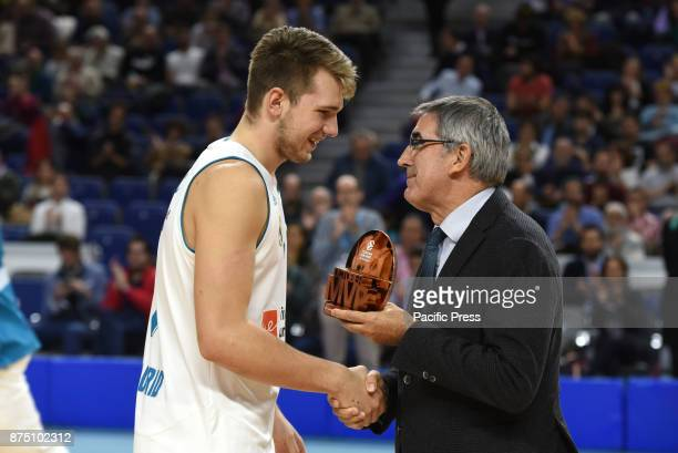 Luca Doncic #4 of Real Madrid with the Eurolegue October MVP trophy during the Euroleague basketball match between Real Madrid and Unicaja Málaga...