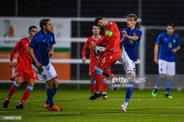 Luca Duriatti of Luxembourg challenges for the ball with Nicolo Rovella of Italy during the UEFA Euro Under 21 Qualifier match between Luxembourg U21...