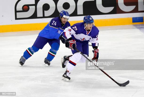 Luca Felicetti of Italy challenges Paul Swindlehurst of Great Britain during the 2018 IIHF Ice Hockey World Championship Division I Group A match...
