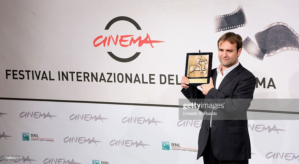 Luca Ferrari poses with his Prospettive Award for Best Documentary during the Award Winners Photocall during the 7th Rome Film Festival at Auditorium Parco Della Musica on November 17, 2012 in Rome, Italy.