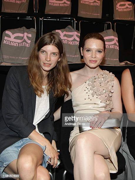 Luca Gadjus and Karoline Herfurth sit in front row at the Kilian Kerner Show during MercedesBenz Fashion Week Berlin Spring/Summer 2012 at the...
