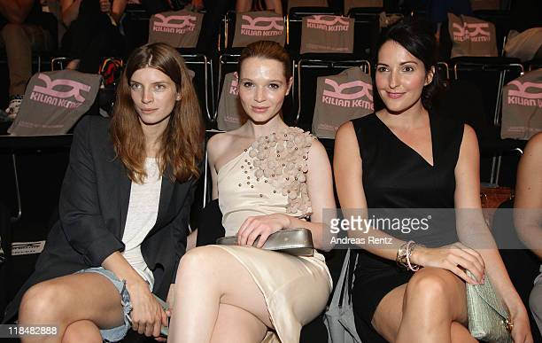 Luca Gadjus Karoline Herfurth and Johanna Klum sit in front row at the Kilian Kerner Show during MercedesBenz Fashion Week Berlin Spring/Summer 2012...
