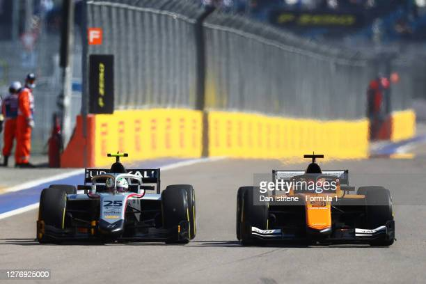 Luca Ghiotto of Italy and Hitech Grand Prix and Jack Aitken of Great Britain and Campos Racing battle for track position during the Formula 2...