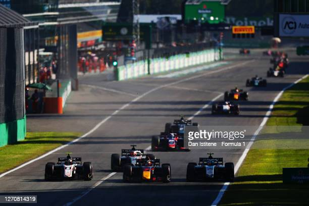 Luca Ghiotto of Italy and Hitech Grand Prix battles for position with Yuki Tsunoda of Japan and Carlin and Christian Lundgaard of Denmark and ART...