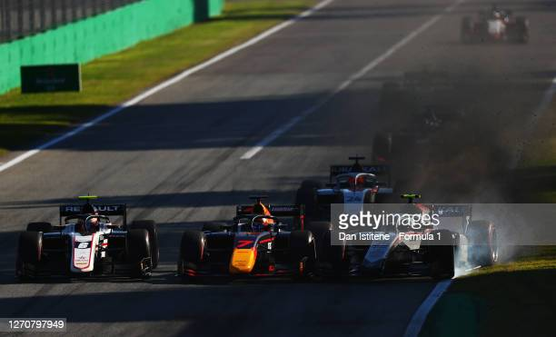 Luca Ghiotto of Italy and Hitech Grand Prix locks up as his battles for position with Yuki Tsunoda of Japan and Carlin and Christian Lundgaard of...