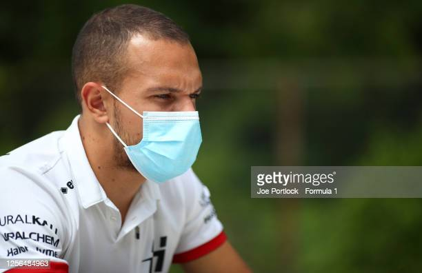 Luca Ghiotto of Italy and Hitech Grand Prix talks to the media in the Paddock during previews for the Formula 2 Championship at Hungaroring on July...
