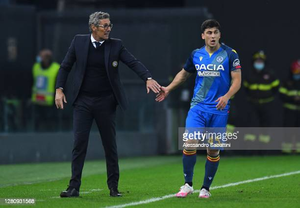 Luca Gotti head coach of Udinese Calcio issues instructions to Fernando Forestieri of Udinese Calcio looks on during the Serie A match between...
