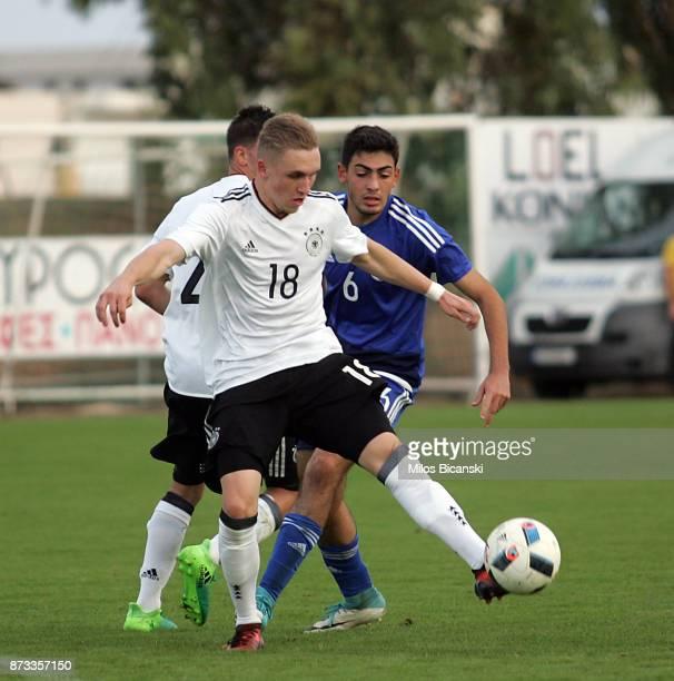 Luca Herrmann of Germany in action against Ioannis Panayides of Cyprus during the U19 International Friendly between U19 Cyprus and U19 Germany at...