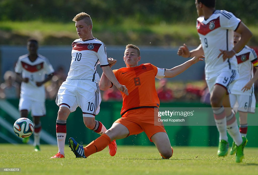 Luca Herrmann of Germany (L) is challenged by Matthijs De Ligt of the Netherlands during the international friendly U15 match between Germany and Netherlands on May 20, 2014 in Weingarten, Germany.
