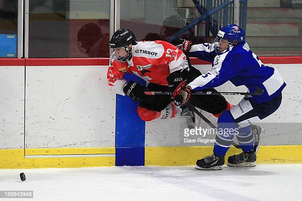 Luca Hischier of Switzerland is tripped up by Julius Honka of Finland during the U-18 Four Nations Cup tournament on November 9, 2012 at the Ann...