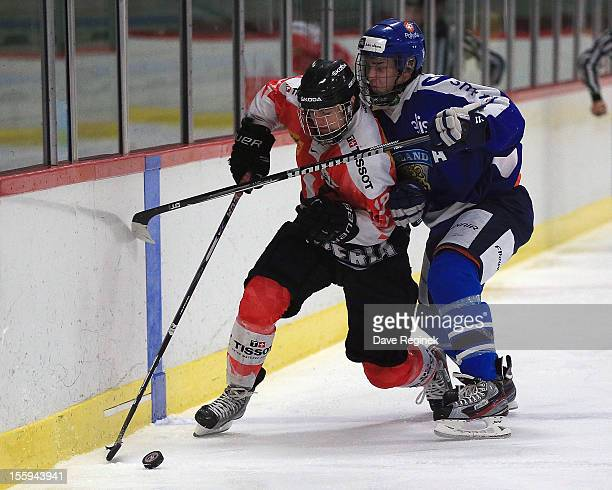 Luca Hischier of Switzerland tries to skate by the defense of Atte Makinen of Finland during the U-18 Four Nations Cup tournament on November 9, 2012...