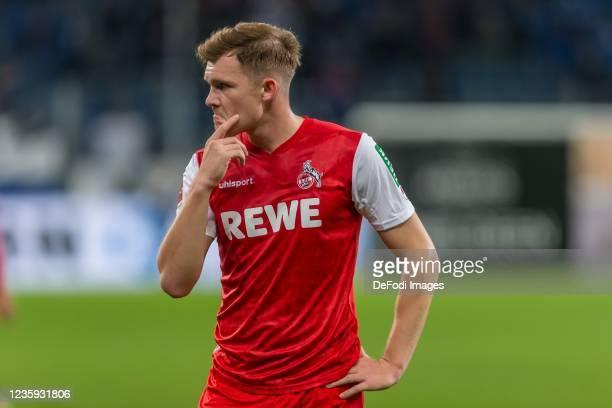 Luca Kilian of 1.FC Koeln looks dejected after the Bundesliga match between TSG Hoffenheim and 1. FC Köln at PreZero-Arena on October 15, 2021 in...