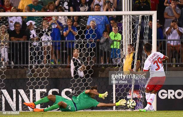 Luca Lezzerini of ACF Fiorentina saves a penalty kick by Mehdi CarcelaGonzalez of SL Benfica to win an International Champions Cup 2015 match at...
