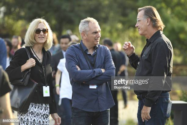 Luca Maestri chief financial officer of Apple Inc center speaks to attendee ahead of an event at the Steve Jobs Theater in Cupertino California US on...