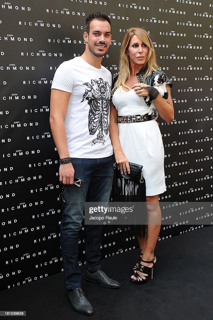 Luca Marin and Guendalina Canessa attend John Richmond during Milan Fashion Week Womenswear Spring/Summer 2014 on September 22, 2013 in Milan, Italy.