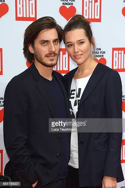 Luca Marinelli and Alissa Jung attend the Ein Herz Fuer Kinder Gala 2013 at Flughafen Tempelhof on December 7, 2013 in Berlin, Germany.