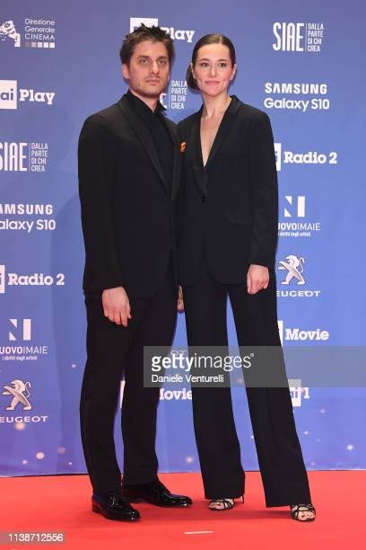 Luca Marinelli and Alissa Jung walk a red carpet ahead of the 64. David Di Donatello awards ceremony - Red Carpet on March 27, 2019 in Rome, Italy.