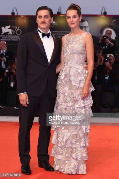 "Luca Marinelli and Alissa Jung walk the red carpet ahead of the ""Martin Eden"" screening during the 76th Venice Film Festival at Sala Grande on..."