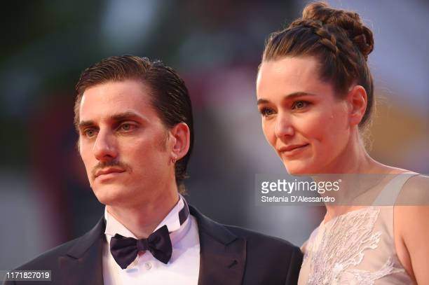 Luca Marinelli and Alissa Jung walk the red carpet ahead of the Martin Eden screening during the 76th Venice Film Festival at Sala Grande on...