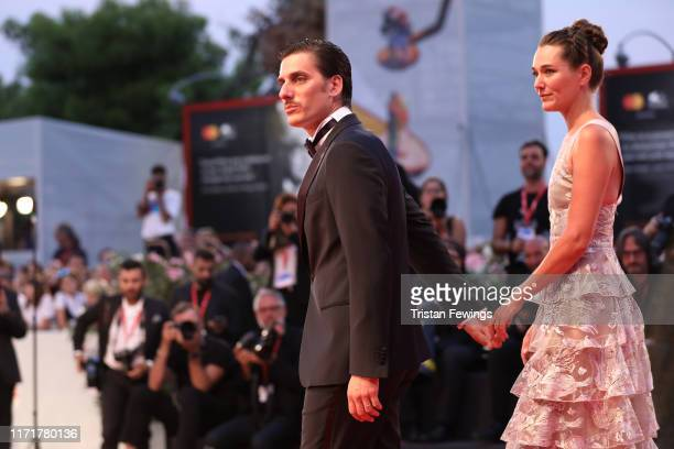 "Luca Marinelli and Alissa Jung walks the red carpet ahead of the ""Martin Eden"" screening during the 76th Venice Film Festival at Sala Grande on..."