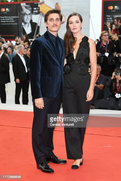 "Luca Marinelli of ""Martin Eden"" and Alissa Jung walk the red carpet ahead of the closing ceremony of the 76th Venice Film Festival at Sala Grande on..."