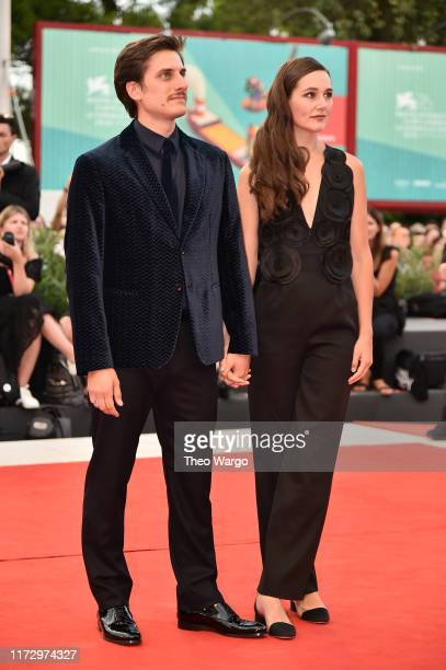 Luca Marinelli of Martin Eden and Alissa Jung walk the red carpet ahead of the closing ceremony of the 76th Venice Film Festival at Sala Grande on...
