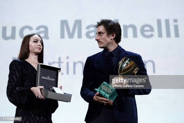 """Luca Marinelli receives the Coppa Volpi for Best Actor Award for """"Martin Eden"""" and a Jaeger-LeCoultre Unique engraved Reverso watch the Award..."""