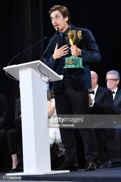 """Luca Marinelli receives the Coppa Volpi for Best Actor Award for """"Martin Eden"""" the Award Ceremony during the 76th Venice Film Festival at Sala Grande..."""