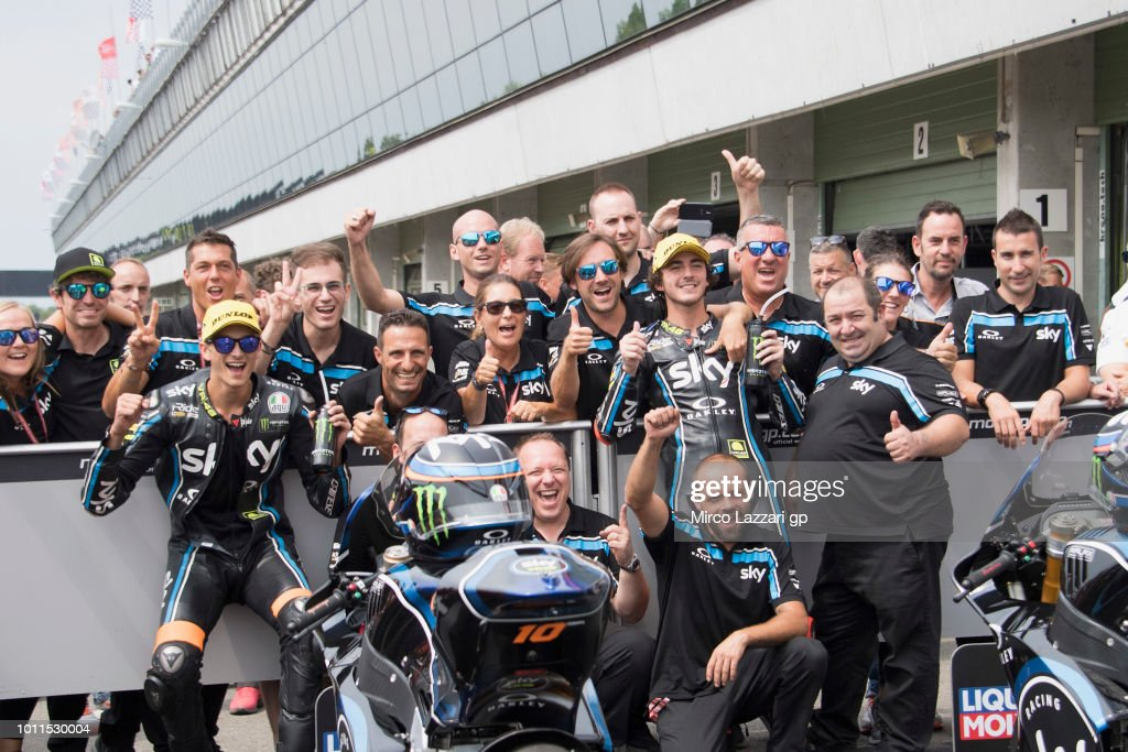 Luca Marini of Italy and Sky Racing Team VR46 and Francesco Bagnaia of Italy and Sky Racing Team VR46 (R) celebrates with team at the end of the Moto2 Race during the MotoGp of Czech Republic - Race at Brno Circuit on August 5, 2018 in Brno, Czech Republic.
