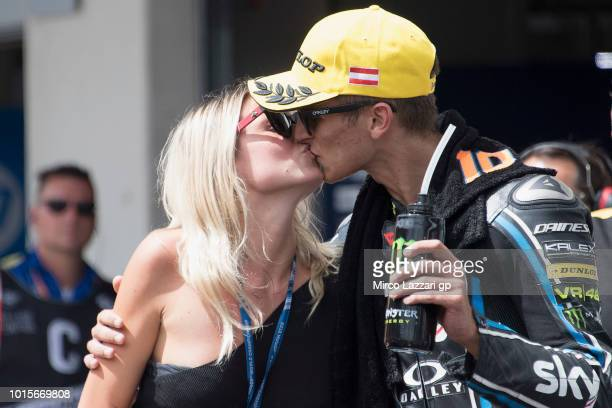 Luca Marini of Italy and Sky Racing Team VR46 celebrates the third place and kiss the girlfriend under the podium at the end of the Moto2 race during...