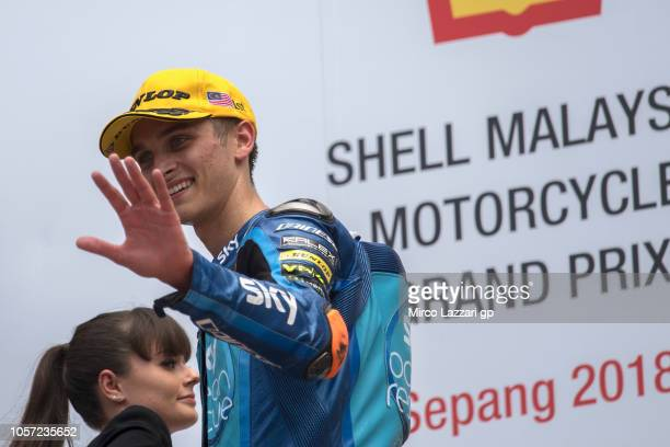 Luca Marini of Italy and Sky Racing Team VR46 celebrates the victory on the podium at the end of the Moto2 race during the MotoGP Of Malaysia Race at...
