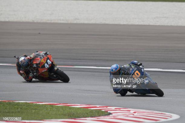 Luca Marini of Italy and Sky Racing Team VR46 leads Miguel Oliveira of Portugal and Red Bull KTM Ajo during the Moto2 race during the MotoGP Of...