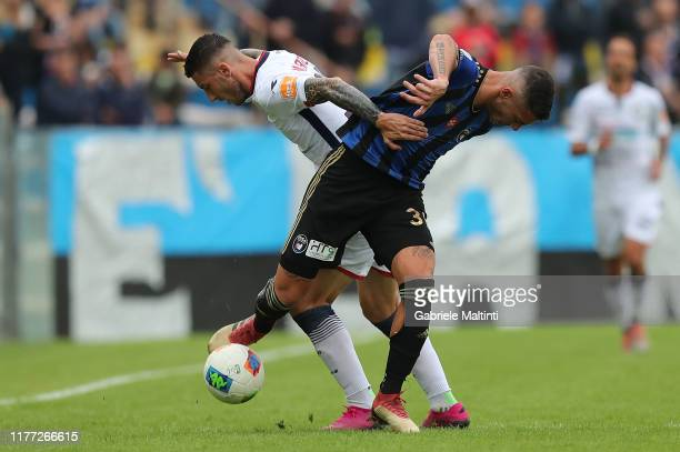 Luca Marrone of FC Crotone in action against Michele Marconi of Pisa SC during the Serie B match between Pisa SC and FC Crotone at Arena Garibaldi on...
