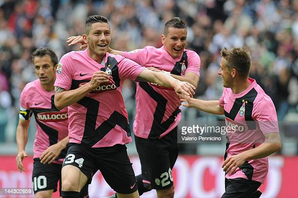 Luca Marrone of Juventus FC celebrates his goal with teammates Emanuele Giaccherini during the Serie A match between Juventus FC and Atalanta BC at...