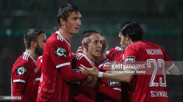 Luca Marseiler of SpVgg Unterhaching celebrates his team`s first goal with his teammates during the 3 Liga match between SpVgg Unterhaching and 1 FC...