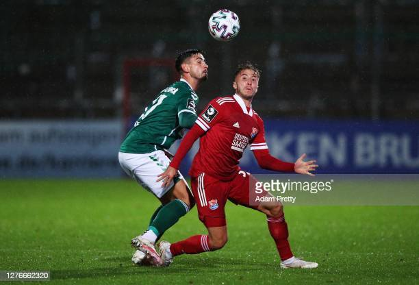 Luca Marseiler of SpVgg Unterhaching is challenged by Nico Rieble of VfB Luebeck during the 3. Liga match between SpVgg Unterhaching and VfB Luebeck...