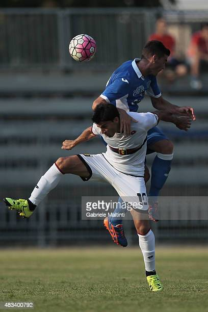 Luca Martinelli of Empoli FC battles for the ball with Diego Perotti of Genoa CFC during the preseason friendly match between Empoli FC and Genoa CFC...