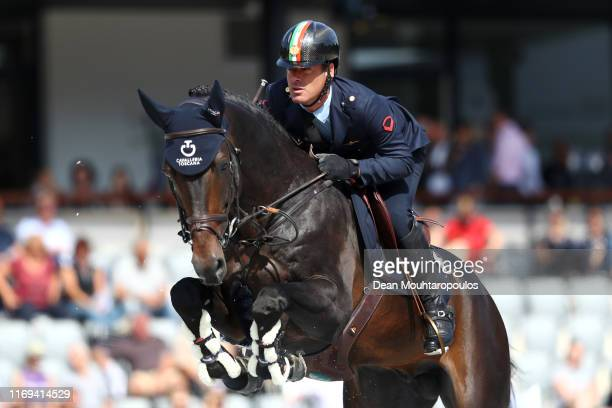 Luca Marziani of Italy riding Tokyo du Soleil competes during Day 3 of the Longines FEI Jumping European Championship speed competition against the...