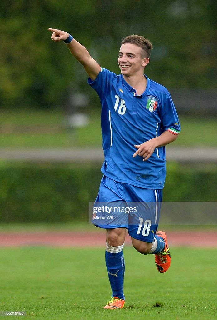 Luca Matarese of Italy celebrates after scoring his team's second goal during the KOMM MIT tournament match between U17 Germany and U17 Italy on September 12, 2014 in Kelheim, Germany.