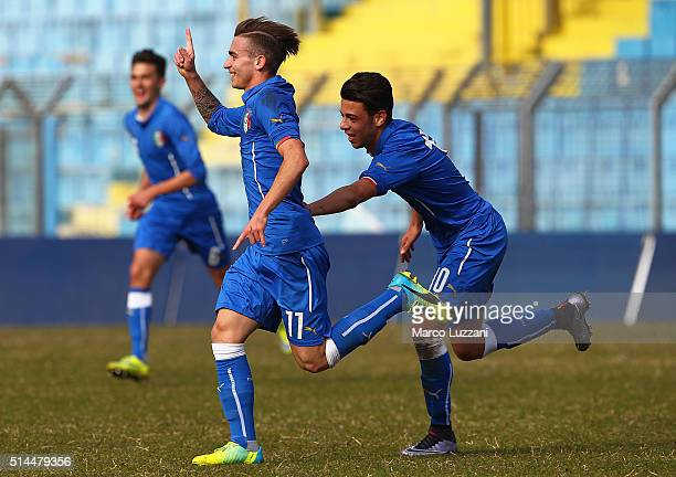 Luca Matarese of Italy celebrates with his teammate Simone Lo Faso after scoring the opening goal during the U18 international friendly match between...