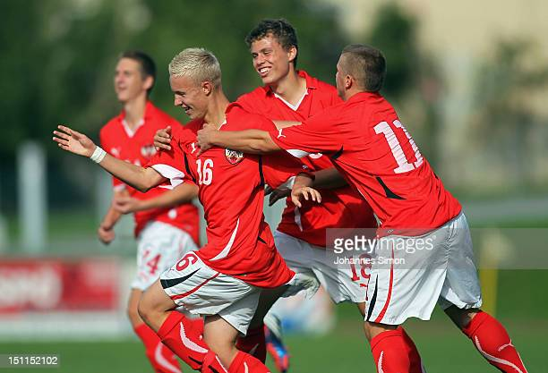 Luca Mayr of Austria celebrates with teammates Marcel Probst Dominik Baumgartner and Petar Gluhacovic after scoring his team's first goal during the...