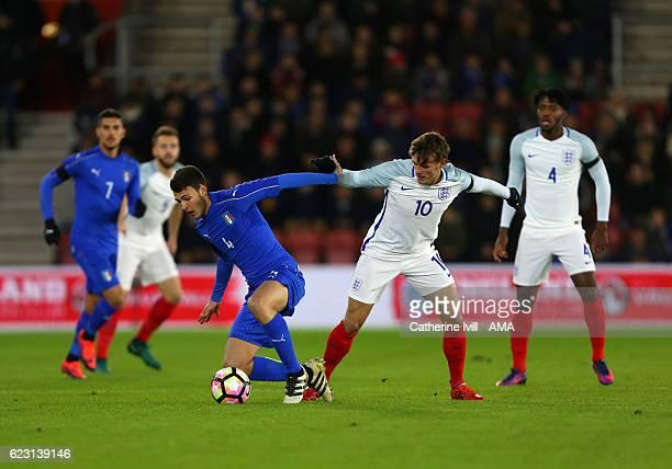 Luca Mazzitelli of Italy U21 and John Swift of England U21 during the U21 International Friendly match between England and Italy at St Mary's Stadium...