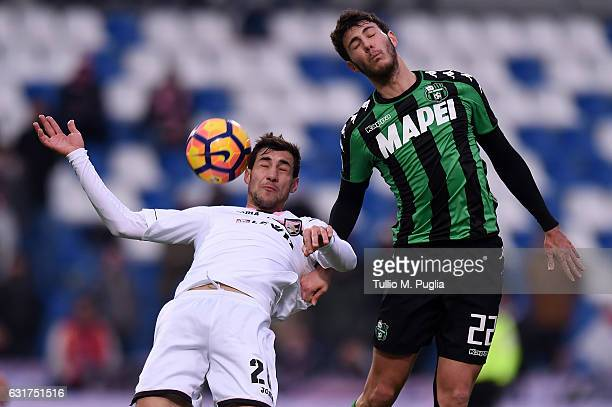 Luca MAzzitelli of Sassuolo and Mato Jajalo of Palermo compete for the ball during the Serie A match between US Sassuolo and US Citta di Palermo at...