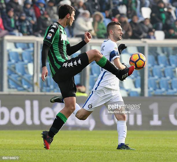 Luca Mazzitelli of Sassuolo competes for the ball with Marcelo Brozovic of Inter during the Serie A match between US Sassuolo and FC Internazionale...