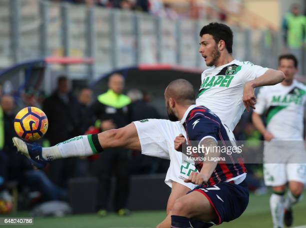 Luca Mazzitelli of Sassuolo is chellenged by Bruno Martella during the Serie A match between FC Crotone and US Sassuolo at Stadio Comunale Ezio Scida...